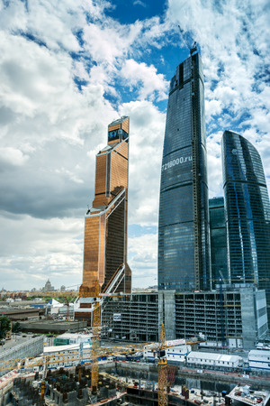 business center: MOSCOW. RUSSIA - JUNE 5, 2015: Skyscrapers of Moscow city business center closeup. Moscow International Business Center also referred to as Moscow-City is commercial district in central Moscow, Russia