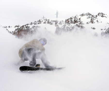 freerider: Freerider snowboarder moving down in snow powder