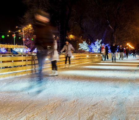 gorky: People are skating in the park on winter skating rink