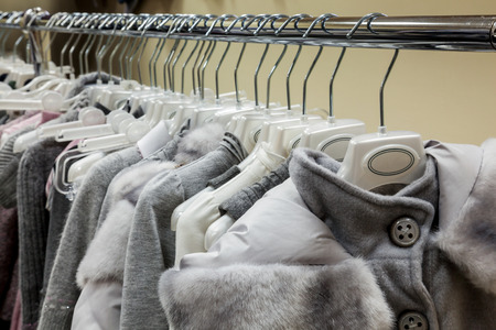 womens clothing: Collection of womens winter clothes on hanger for sale at the store