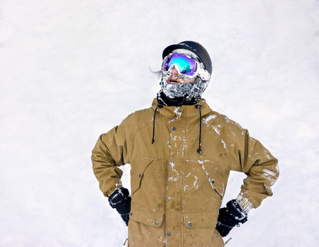 powder snow: Portrait of bearded young man in sunglass a fallen face in the snow at the ski resort
