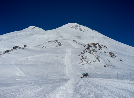 snowcat: Snowcat rathrak with people, rises to the top of the mountain up. Beautiful landscape of the North Caucasus Mountains at Elbrus Stock Photo