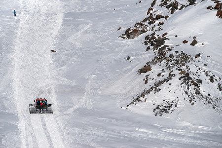 snow grooming machine: Snowcat rathrak with people, rises to the top of the mountain up. Beautiful landscape of the North Caucasus Mountains at Elbrus Stock Photo