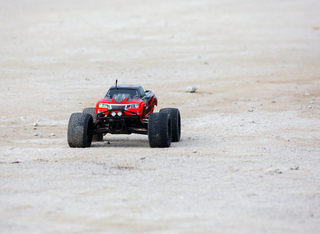 Radio controlled car model in race quickly moving on the sandy road Stock Photo