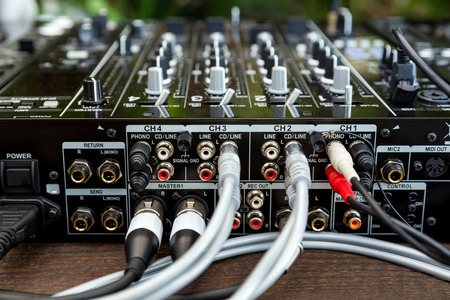 grounding: DJ CD player and mixer in a nightclub in daylight on outdoor party