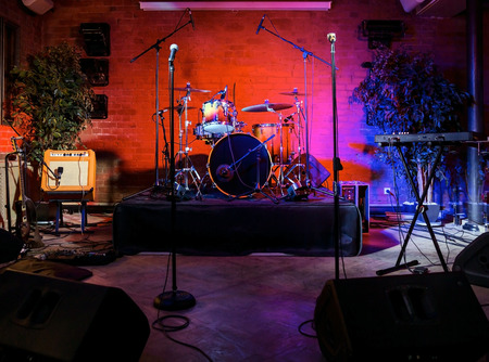 party system: Rock concert stage with musical instruments in nightclub