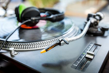 Dj mixer and vinyl player with headphones at club