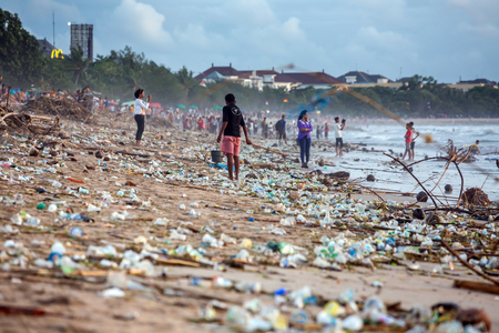BALI, INDONESIA - FEBRUARY 12, 2017: Beach pollution at Kuta beach, Bali. Many garbage on the beach