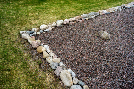 Circular line in Feng Shui garden zen stones on a background of small pebbles