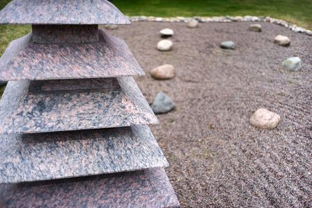 Pyramid of granite slabs on background in Feng Shui garden zen stones on of small pebbles Banco de Imagens