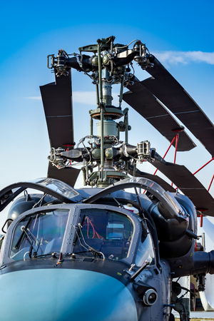 Military helicopter rotor blade and folded blades closeup on background blue sky