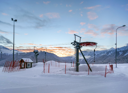 Cableway in beautiful mountain landscape of the Caucasus at sunrise. Open chairlift road