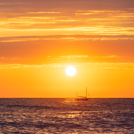 Private yacht in the distance and beautiful seascape at sunset day in summer season Stock fotó