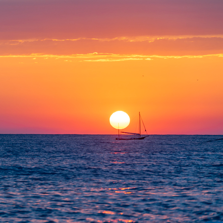Private yacht in the distance and beautiful seascape at sunset day in summer season
