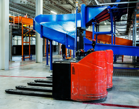 Sorting line for cargo in large modern warehouse with forklifts