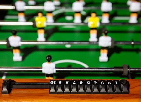 Classic foosball, keeping score from one to 10 points on the playing field close-up