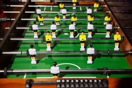 Classic foosball, a fragment of the centre playing field with rows of player figures close-up