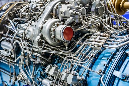 Engine of fighter jet, internal structure with hydraulic. Fuel pipes and other hardware equipment of army aviation and aerospace industry Stockfoto