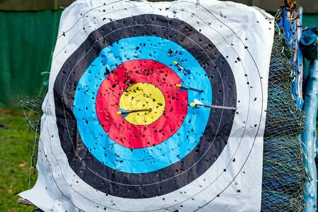 Standard colorful target for archery with arrows close up Stock Photo