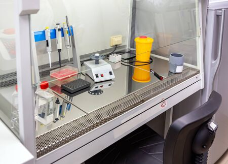 Laboratory medical equipment on special table in the center of epidemiology for the search and solution of viral diseases