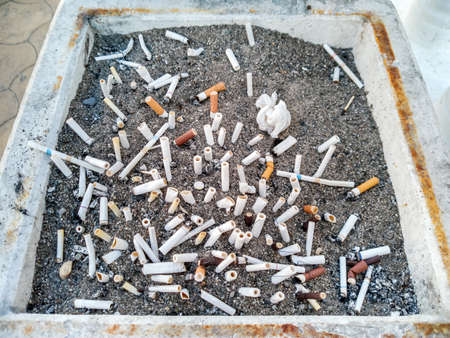 Smoking area and an ashtray filled with coarse sand to extinguish cigarette lights, intended for people who smoke Standard-Bild
