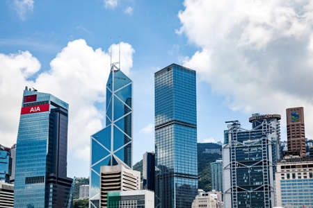 Hong Kong - July 3, 2011: View of modern skyscrapers in heart of megapolis. Hong Kong city is an international financial center, which consists of 112 buildings, standing higher than 180 meters Editorial