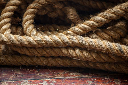 Rope on the deck of the ferry on background of the old wooden floor