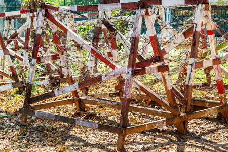 Many rows of wooden structures in the form of fence with rusty barbed wire to ensure safety at the right time