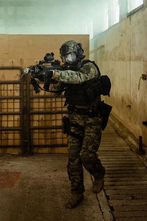 Armed soldier in Cropat pattern uniform wearing M95 Gas mask and assault rifle HK G36. Reklamní fotografie