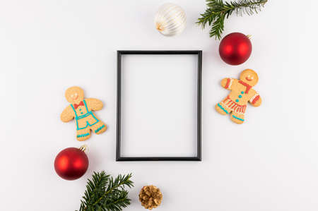 Christmas theme minimalist picture frame. Frame surrounded with Christmas decorations. Flatlay minimal style. Stock Photo