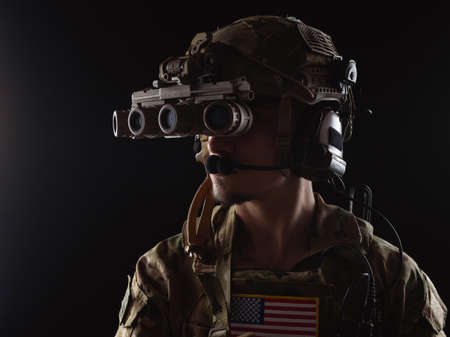 Delta Force soldier, US army special forces. Combat application group, Army compartmented element operator - Tier 1. Portrait on a black backdrop with rifle and night vision.