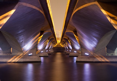 A light show and shadow of under Esplanade Bridge, Singapore. Stock Photo