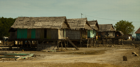 fishing village: Reed houses in a fishing village near Riung on Flores Island, Indonesia. Stock Photo