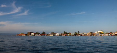 palapa: Houses on the shore of the island of Colon in Bocas del Toro which is the capital of the province of the same name in the Caribbean West of Panama.