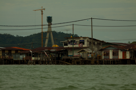sufficient: Bruneis Famed water village Kampong Ayer in Bandar Seri Begawan, Brunei on Villages are fully self sufficient with their own water, shops. It s one of the richest countries