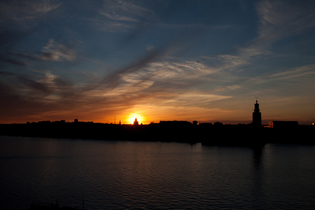 old town guildhall: View of the skyline of Stockholm during sunset in June, Sweden