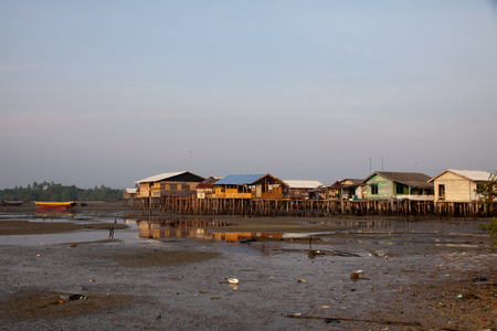 stilted: Stilted houses in village on a river on Bintag Island, Indonesia
