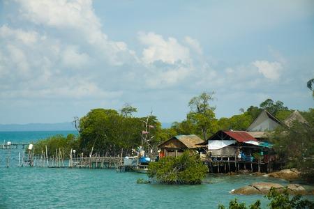 Wooden houses on piles seen on Pulau Sibu Island, Malaysia