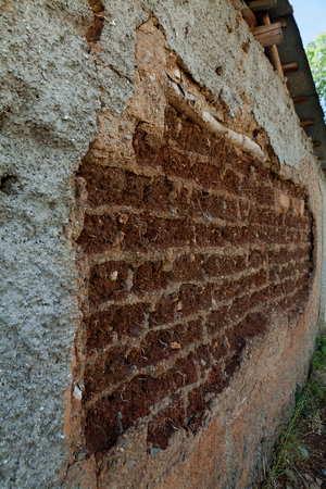 adobe wall: Wall of old adobe house closeup in sunny day