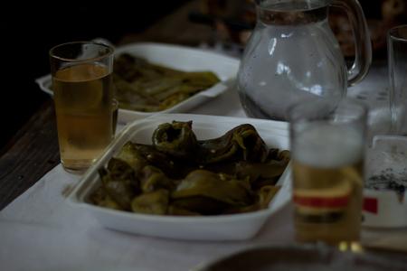 rakia: Traditional Macedonian food different kind of meat, salats, breads, beer and Rakia - krvavica sausage with shopska salad, shallow dof