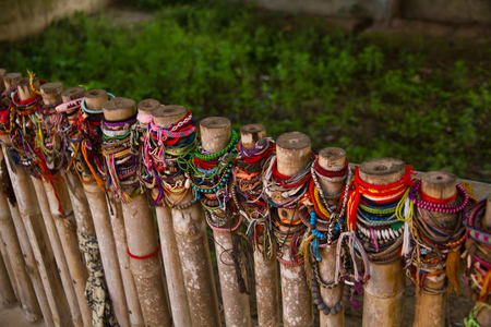 Colored bracelets dedicated to the victims of the killing fields of Choeung Ek Stock Photo