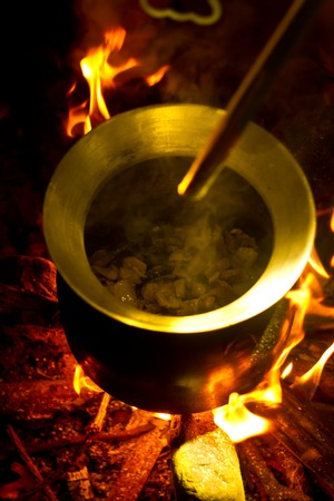 outdoor fireplace: Cooking in a pot over campfire in the jungle of laos Stock Photo