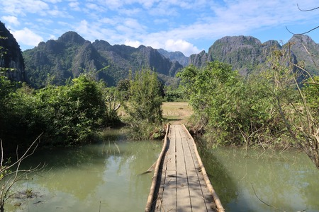 pedestrian bridges: Wooden bridge in the countryside of laos Stock Photo