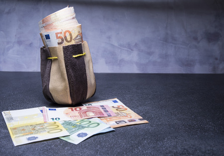 sac: Euro banknotes stuffed in the old pouch