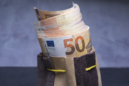 sac: Closed up of fifty euros stuffed in the old pouch