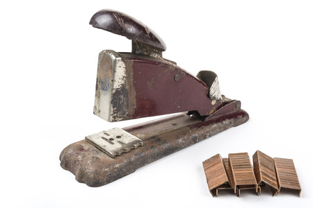 Old vintage retro metal stapler with staples isolated on white background Stock Photo