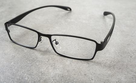 shortsightedness: Full frame dioptric eye glasses on the table Stock Photo