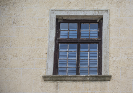 Old window in the city in summer day 版權商用圖片