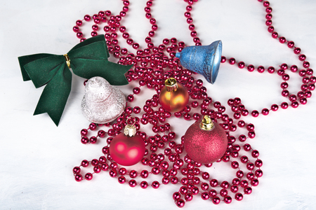 Christmas background with decorations  bells, ribbon on white. Stock Photo
