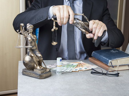 Statue of Justice Themis with money euros and dollars. Bribe and crime concept Stock Photo